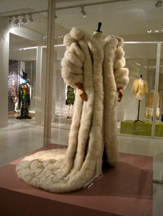 Marlene Dietrich's swan down coat. She first wore it in 1957 at the Sands Hotel in Las Vegas and numerous times thereafter in the 1960s. The feathers of over 300 swans were needed to make the coat, which was 360cm long from collar to tail. The coat was worn over a dress that was made with 227,000 rhinestones. The designer, Jean Louis of Hollywood, was head designer for Columbia Pictures