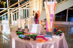 This #partybar, complete with #funky #glasses + #glowsticks, made for #extra #fun on the #dancefloor at this #weddingreception! ::Amber + Chris's striking wedding at Peachtree Road United Methodist and the Fernbank Museum of Natural History in Atlanta, Georgia:: #bagoftricks #keepdancing #partytime #weddingphotography