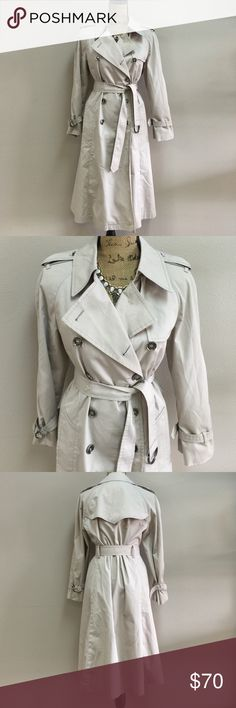 """LONDON FOG Double Breasted Trench The classic fall trench coat given a modern update. It features all the timeless details of a double breasted trench coat, including a button front, tie belt and epaulets at the shoulders, but with a little twist, an asymmetric flap at the shoulder to give the look a little flair. 45"""" Length and Shoulder to shoulder is 21"""" London Fog Jackets & Coats"""