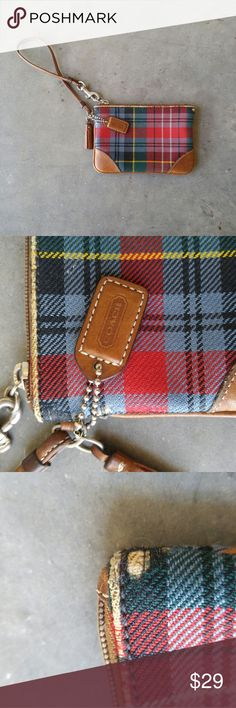 """Coach Plaid Wristlet - Damaged - Make An Offer Coach plaid wristlet with considerable wear on the corners and top edges. Otherwise functional. 5.5"""" x 4"""". Strap is 6.5"""". Make a reasonable offer! Thanks! Coach Bags Clutches & Wristlets"""