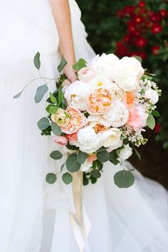 These heritage roses makes this bouquet over the top romantic and dreamy. To pretty for words!