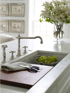 Kitchen Island: Marble countertops, faucet and sink.