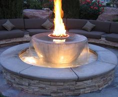 Beautiful outdoor seating area with a fire pit/fountain. http://curatedstyle.tumblr.com/post/33054187516