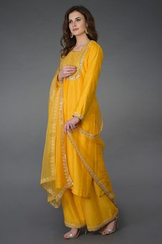 From our Indian Spring Collection, this Sunglow Yellow farshi palazzo suit is adorned with beautiful pearl beads, gota patti, sequin, zari and zardozi hand embroidery. The kurta and farshi ( wide leg palazzo pants) are crafted in chanderi and the Pakistani Dress Design, Pakistani Dresses, Indian Dresses, Indian Outfits, Indian Clothes, Designer Party Wear Dresses, Indian Designer Outfits, Gota Patti Suits, Palazzo Suit
