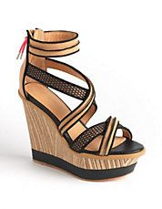 Leather straps and a closed, zippered heel offer a trend-right style to these L.A.M.B. sandals! #lordandtaylor