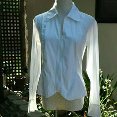 """Coldwater Creek Petite White Zip Up Blouse NWOT versatile fitted white shirt. Sleeves can be turned up for cuffs or not. Side slits make it perfect to wear untucked. 96% cotton, 4% spandex. Flat measurements: shoulder to shoulder 15 1/2""""; pit to pit: 19""""; sleeve with cuff down: 24 1/2""""; length: 24"""". Coldwater Creek Tops Blouses"""