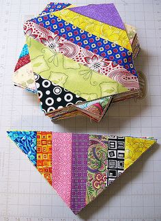 I've completed all of the blocks (82) and triangles (28) for my Summer Stash Challenge string quilt.  Blogged here
