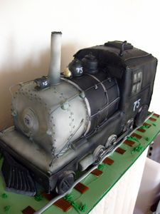 Sculpted Train Cake by Amanda Oakleaf Cakes, via Flickr