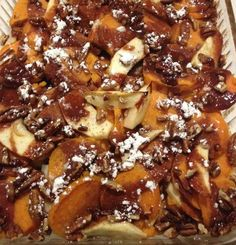 6 large sweet potatoes 4 Red Delicious apples 1/2 cup coarsely chopped pecans 1/4 cup honey 1/4 cup orange juice 2 teaspoons ground cinnamon 2 tablespoons vanilla extract 1/2 cup powdered sugar