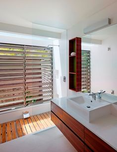 Contemporary Bathroom by Bark Design Architects// the wood floor lifts up to reveal a sunken bathtub!