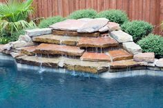 Waterfall With A Ledgecut Strip Retaining Wall And