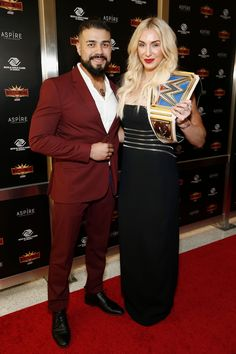 Andrade and Charlotte Flair attend the WWE Superstars For Hope Reception on April 2019 in New York City. Wrestling Superstars, Women's Wrestling, Charlotte Flair Wwe, Wrestlemania 35, Wwe Couples, Andre The Giant, Wwe Tna, Raw Women's Champion, Wwe Wrestlers