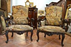 Very fine, Venetian, Rococo period salon: Comprised of two fauteuils and matching canapé. In solid, carved walnut with original Savonnerie tapestry.