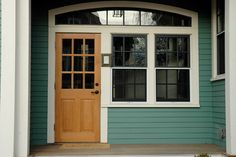Exterior paint with wood door. Main house color is Sherwin-Williams SW 6473 Surf Green. House Paint Exterior, Exterior Paint Colors, Interior And Exterior, Cottage Paint Colors, House Doors, Green Gables, Maine House, Cottage Homes, The Ranch