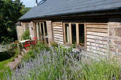 self-catering barn sleeping 4 overlooking the Black Mountains, set in 48 acres of hillside and woodland, Garn Farm provides the perfect escape. Cosy, Lavender, Shed, Barn, Outdoor Structures, House Styles, Home Decor, Converted Barn, Decoration Home