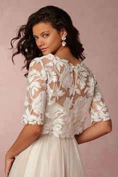 Find the perfect wedding dress cover up at BHLDN, Anthropologie's sister brand. Shop our stunning collection of vintage-inspired wedding boleros. Wedding Dress Topper, Wedding Dress Sleeves, Wedding Bridesmaid Dresses, Wedding Gowns, Lace Dress, Illusion Neckline Wedding Dress, Bridal Cover Up, Unconventional Wedding Dress, Bridal Separates