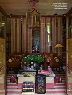 Anouska Hempel ~ profusion of books and objects top an ottoman in reception room of her London home