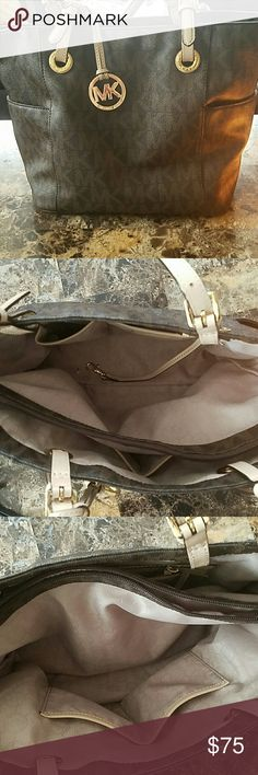 Michael kors handbag Brown logo michele kors handbag. Used everyday for about 2 months. Still in great condition!!   2 large compartments in the middle separated by a middle pocket. 4 pockets on the inside for phone, keys etc. A hook for keys. Another small zipper pocket on inside. And 2 side pockets on the outside.  NO TRADES Michael Kors Bags Shoulder Bags