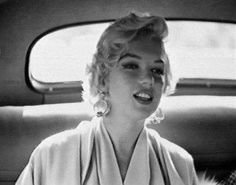 """Marilyn on arrival in New York to film scenes for """"The Seven Year Itch"""". Photo by Sam Shaw, September 9th 1954."""