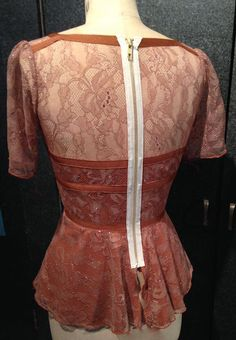 My work.  Lace, ribbon and silk.  Exposued zipper.  Unexpected back treatment and on trend