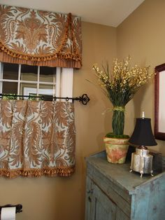 highly stylized valance with cafe curtain for a more formal look