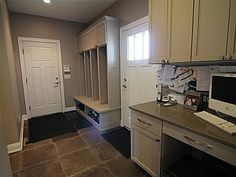 mudroom with lockers and desk