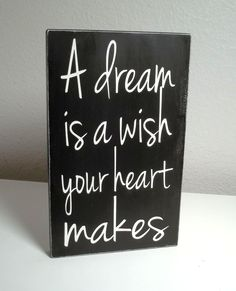 Black and White Disney A Dream Is A Wish Your Heart Makes Painted Wood Sign. $10.00, via Etsy.