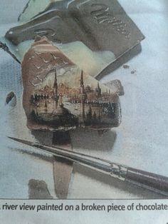 How amazing is this, artist Hasan Kale from Istanbul  painted this river view on a broken piece of chocolate. he also has drawn on grapes cherries and seeds he started 20 years ago when he realised he could draw extremely thin lines, like i said amazing.