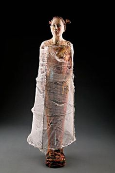 Debra Fritts.  I know it's not an art doll, but the mixed media is inspiring.