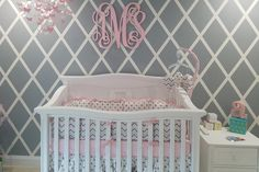 Imperio Convertible Crib in Solid White with a beautiful Pink and Grey color palette. Simply sophisticated, nursery design goal delivered!