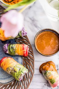 These healthy Rainbow Spring Rolls with a spicy Vietnamese peanut sauce are a colorful vegetarian recipe perfect for Spring's fresh veggie bounty. food vegetarian vegetarian dinner vegetarian easy vegetarian i Spicy Peanut Sauce, Vietnamese Food, Vietnamese Recipes, Vietnamese Spring Rolls, Peanut Butter, Papaya Recipes, Asian Recipes, Ethnic Recipes, Breakfast