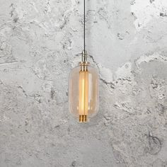 Gold Glass Pendant Light CL-34104  Modern gold glass pendant light is a glass shade and gold detailing around the fitting.