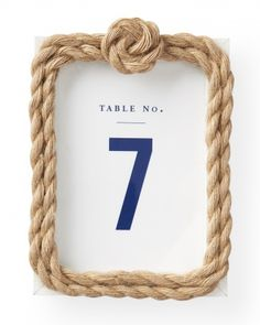 Nautical Wedding Idea: Framed Table Numbers. Transform a basic white Ikea picture frame with a knot and two laps of 10mm twist cord (mjtrim.com) secured with glue.