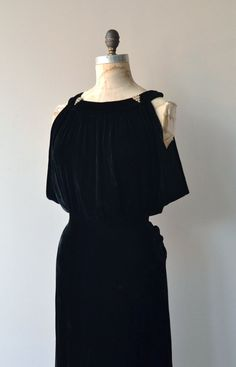 Vintage 1930s jet black silk velvet gown with alluring neckline set off with rhinestone dress clips (removable), fluttery sleeveless bodice with