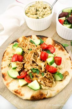Slow Cooker Chicken Shawarma in a pita with hummus and salad.