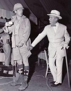 """Danny Kaye in costume from """"Merry Andrew"""" visits Maurice Chevalier on othe set of """"Gigi"""""""