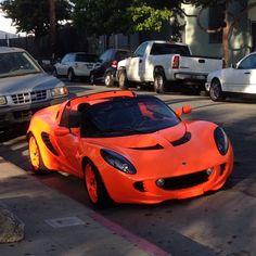 Neon orange car. Cool!