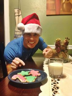 Aww he looks so happy he has his Christmas cookies and every thing