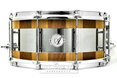 Acoutin Stave Black Walnut & Oak/Stainless Snare Drum 14x6.5 A Patented design allowing one drum to achieve the tonal qualities of multiple snare drums through the use of interlocking edges. Providing changes in Pitch, Resonance, Sustain and Decay with the quick change of each edge. Purchase Here: http://www.drumcenternh.com/drums/snare-drums/acoutin-stave-black-walnut-oak-stainless-snare-drum-14x6-5.html