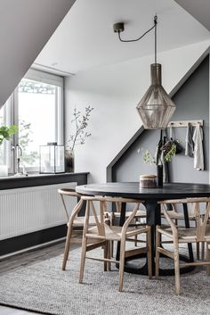 dining space. round black table, wishbone chairs