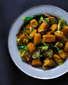 pumpkin gnocchi - oh the wonderful things you can do with something orange and round. Can't wait to try this once cooler weather sets in!