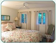 Room 3: Standard Room  This is our coziest room with a queen custom designed and built bed and armoire, wide pine floor, flat panel TV/DVD, and private shower bath that overlooks the Merriman State Forest.