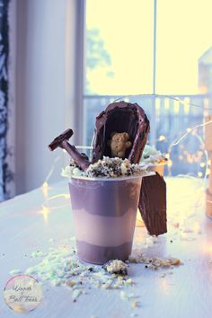 Create a fun & exciting Snack Pack graveyard with hidden surprises, like graham cracker coffins, cookie & cracker dirt & coconut grass perfect for parties!