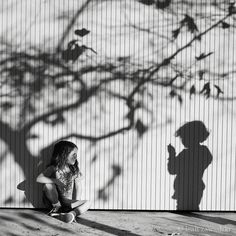 love the girl in front of tree shadow.  and the patchy light on her.