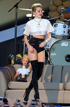 Miley Cyrus Short Shorts - Miley showed off some skin with these black bootie shorts.
