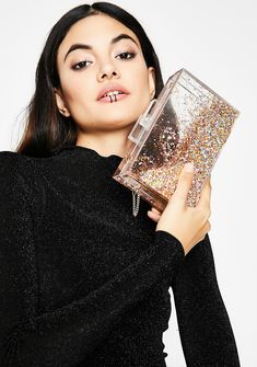 Let'z Celebrate Glitter Bag cuz you always have somethin' to celebrate. This clear box bag has multicolor glitter details and a long chain strap.#dollskill #datenight #valentinesdaygiftideas #valentinesday #glitter #sequins #hearts #red #silver
