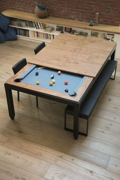 Pool table under the dinner table.  Great idea