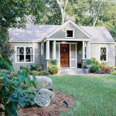 Mixing shingles and siding adds variety to this cozy bungalow. More home exteriors: http://www.bhg.com/home-improvement/exteriors/curb-appeal/before-and-after-home-exteriors/?socsrc=bhgpin050313graybungalow=15