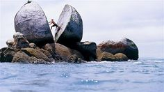 Split Apple Rock in the Abel Tasman National Park on New Zealand's Southern Island is a spherical granite formation that was split in two