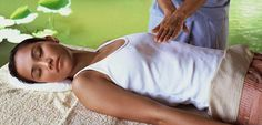 A person receiving Reiki stays fully-clothed. Many photos depict a person receiving a massage (and receiving Reiki) while they are unclothed on a massage table. It is true that a person may receive Reiki, along with having a massage. Yet, if a person is 'only' receiving Reiki, the photo will depict the person sitting up in a chair, or lying down on a massage table, fully-clothed.